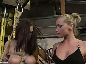 Kathia Nobili smacking the bum of hot woman with whip