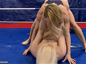 Brandy grin & Nikky Thorne grapple each other